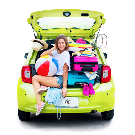 Ready to travel. Woman in Green Overloaded Car with Stuff Things before Trip. Bright Suitcases Luggage Full Stuff Accessories Clothes Ballon. Summer Concept Holiday Adventure Isolated on White.