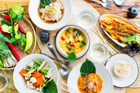 Table top view Thai traditional cuisine. Pad Pak Ruam Mitr Stir vegetables. Red curry chicken coconut soup. Pad Pak Ruam Mitr. Herbs spicy Water Rice Asian national Main dishes Spicy food Restaurant Banque d'images