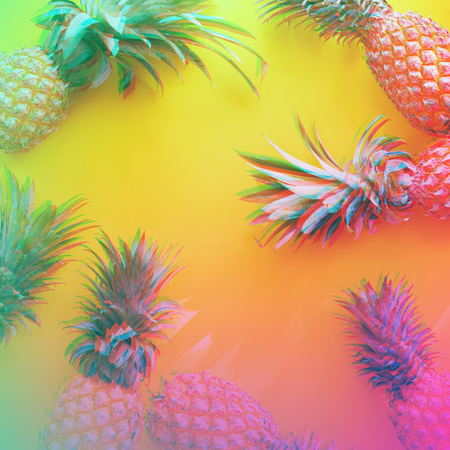 Whole pine apple Tropical fruits with leaves Yellow background useful natural organic food Top view Flat lay Group objects. Glitch style effect. Vibrant duotone yellow, violet colors