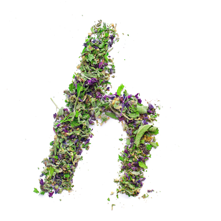 Letter h english alphabet. Herbal tea from dried up sage, melissa leaves isolated on white background. Lettering from natural material. texture. Top view