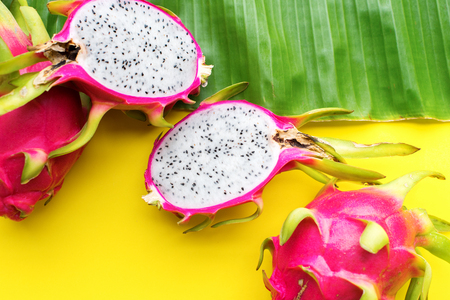 Pitahaya tropical fruits on yellow background. Raw eating concept. Summer time. Season local food product of Thailand. Flat lay top view