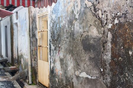 Ruined cement facades of houses in Malaysia. Poor slums for accommodation of low segments of the population