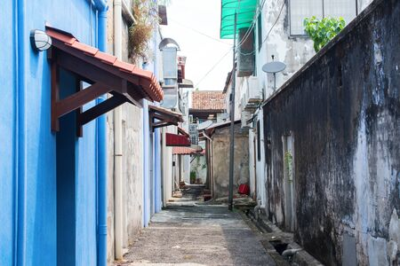 Malaysia street with ruined facades of houses from cement. Poor slums for accommodation of low segments of the population Stock Photo - 126471760