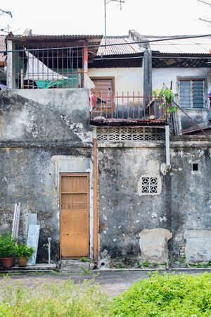 Ruined facades of houses from cement in Malaysia. Poor slums for accommodation of low segments of the population