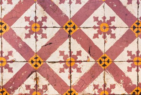 Pattern geometrical national bright colored tiles laying from streets of Malaysia. Vintage of retro antique style