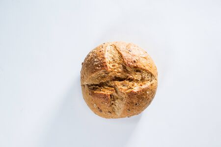Whole grain bread with seeds on light gray background. Top view flat lay. Healthy food