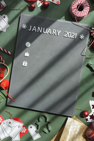 Typesetting plastic board with white letters JUNUARY plan for a year. Calendar flat lay. Christmas time 2021 plan