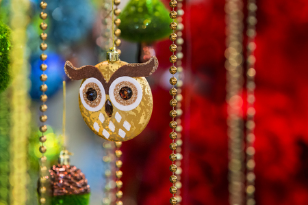 Beautiful gold tree toy in the form of an owl, beads, tinsel, decoration on Christmas tree