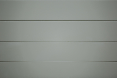 Gray vinyl wooden siding panel background texture.