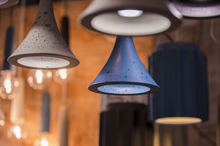 Modern light bulbs in a cafe. Ceiling light fixtures. Chandelier from cement.