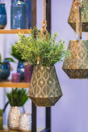 Metallic bronze hanging flower pot with decorative flower Stok Fotoğraf