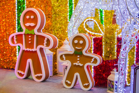 Street Christmas decoration, a huge figure of a Gingerbread man with garlands.
