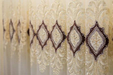 Beautiful thin curtains texture, transparent tulle, examples in the store. Imagens