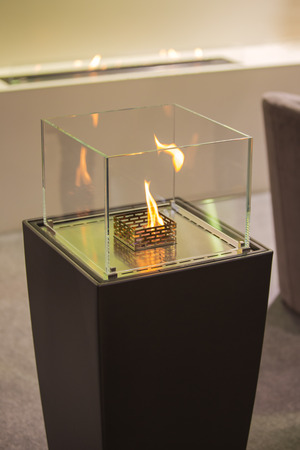 The flames in electric fireplace close-up. Interior design.