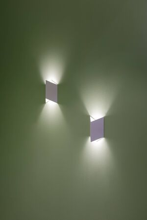 Beautiful group of modern wall lamp interior contemporary decoration.  LED lights on wall create shape with light and shadow.
