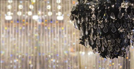 Elegant black royal crystal chandelier. Ñurtain of glass drops on background. Place for text banner. Archivio Fotografico