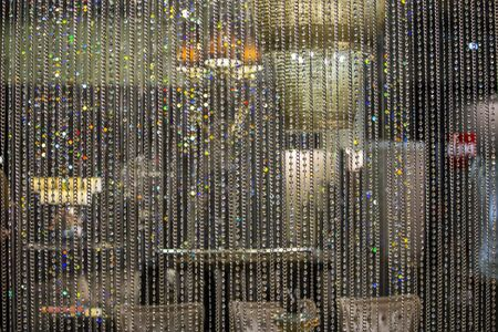 Curtain of glass drops. Crystal beads blind curtain background, concept of Luxury   backdrop for wedding celebration Invitation. 写真素材