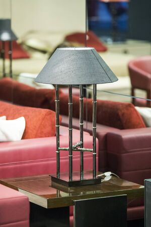 Coopper fashionable bedside lamp, modern lamp in the interior. Stockfoto