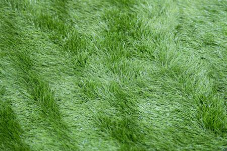 Top view of artificial grass. Floor coverings for playgrounds. Banque d'images - 129018895