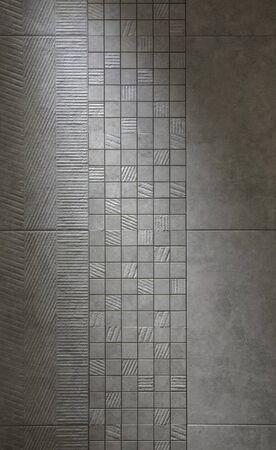 Slate tile ceramic, texture light gray.  Porcelain tile in the bathroom.