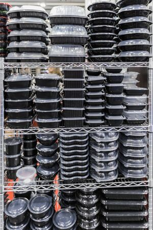 Plastic black containers with a transparent lid, stacked empty food containers. Zdjęcie Seryjne