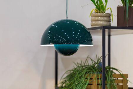 Pendant lamp modern hemisphere form, specular surface, green color. Stockfoto