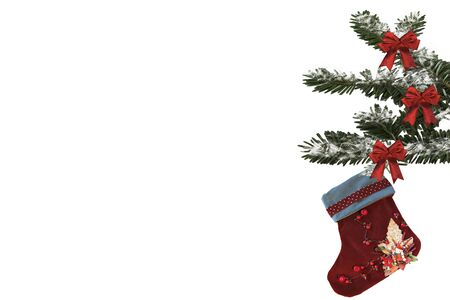 fir branch with ribbons and a Christmas sock on a white background Banco de Imagens