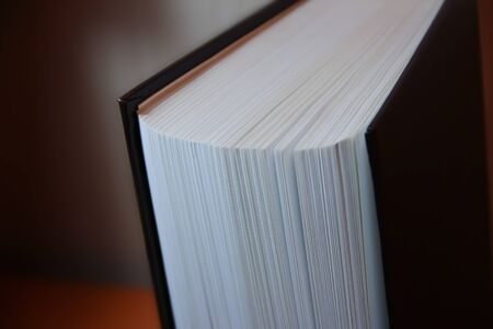 the pages of a thick book from the near