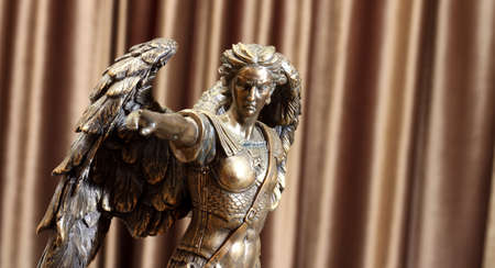 Statuette of the Archangel Michael on a velor background.