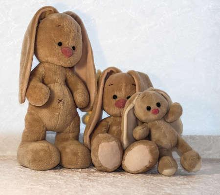 Bunnies on a white background. Plush rabbit toy. Foto de archivo