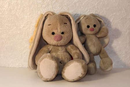 Bunnies on a white background. Plush rabbit toy.