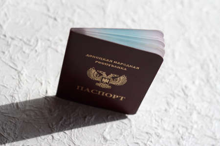 Passport of the Donetsk people's Republic on a white crumpled background. The inscription in Russian: Donetsk people's Republic, passport. Stock Photo