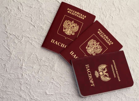 Passport of the Russian Federation and passport of the Donetsk people's Republic. The inscription in Russian: Russian Federation, passport, Donetsk people's Republic Stock Photo
