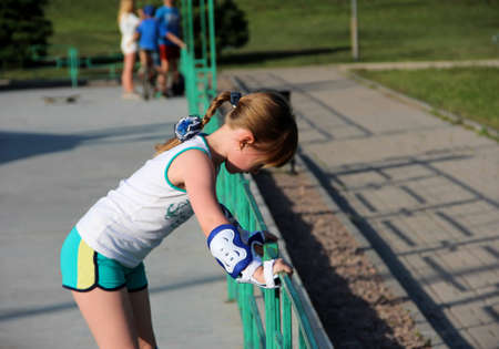 A girl rollerblading in the Park. The child is engaged in sports. Asset in the fresh air. Children Of Donbass. The city of Donetsk, Park of a name Petrovsky 06/14/2020 year. Donbass