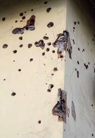 Shelled wall of a residential building. Consequences of the war in the Donbas. Housing stock of the DPR. Holes from fragments of a mine.