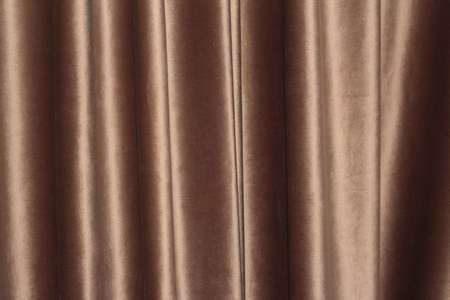 Velor background with drapery. Velor color of coffee with milk. Velor background with pleats.