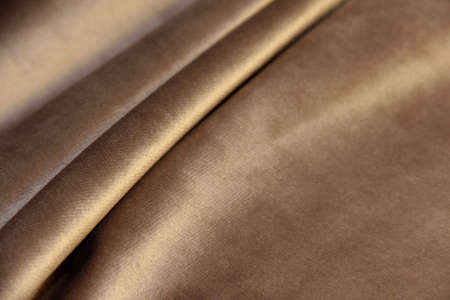 beige velor with pleats. Drapery on plush fabric