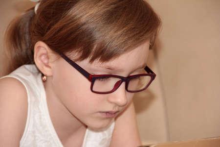 Beautiful girl in purple glasses. Cute baby