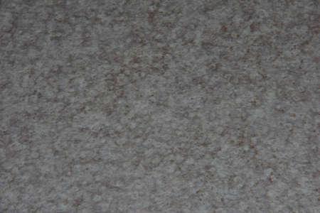 Light textured surface. Texture of the kitchen countertop.