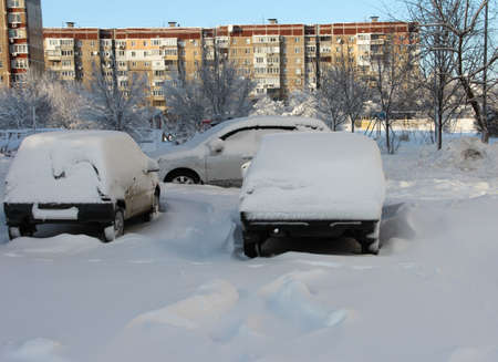 Snow-covered cars of the city of Donetsk. Dangerous snowfall.