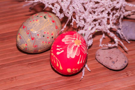 Easter eggs on a wooden background. A pink, colored egg.