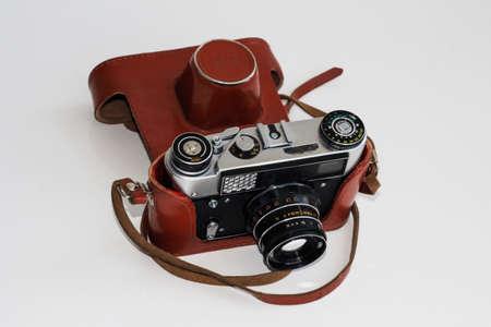 Soviet camera on a light background in a case.