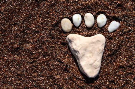 Leg made of sea stones. White sea pebbles. Sea background. Stock fotó