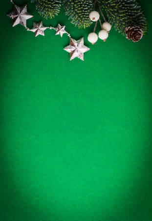Green background with Christmas tree, pine cone, stars and beads.