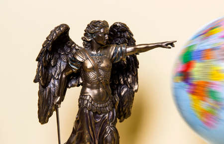 Archangel Michael on a beige background with a globe.