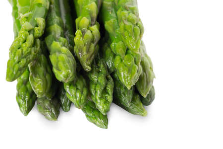 Frozen asparagus on a white plate. Healthy food.
