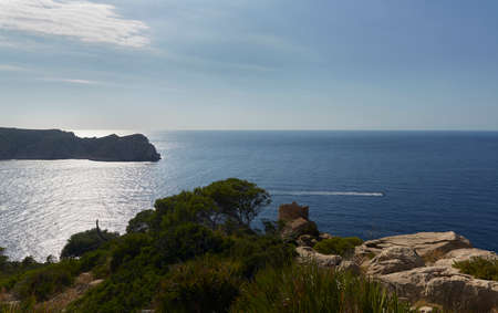 Panoramic of the La Trapa tower and part of the Dragonera island, located in San Telmo, a small town that is part of the Spanish municipality of Andrach, in Mallorca, Spain