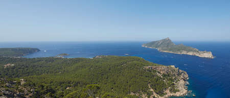 Panoramic of the Torre de Cala en Basset and the island of Sa Dragonera, taken from La Trapa, an old monastery located in San Telmo, Spanish municipality of Andrach, in Mallorca, Spain