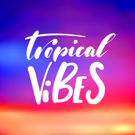 Tropical vibes - handwritten lettering, summer holiday quote on abstract blur unfocused style sky backdrop