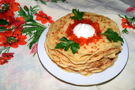 convivial: Appetizing pancakes with red caviar. Traditional cuisine. Stock Photo